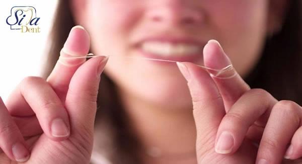 نحوه صحیح کشیدن نخ دندان